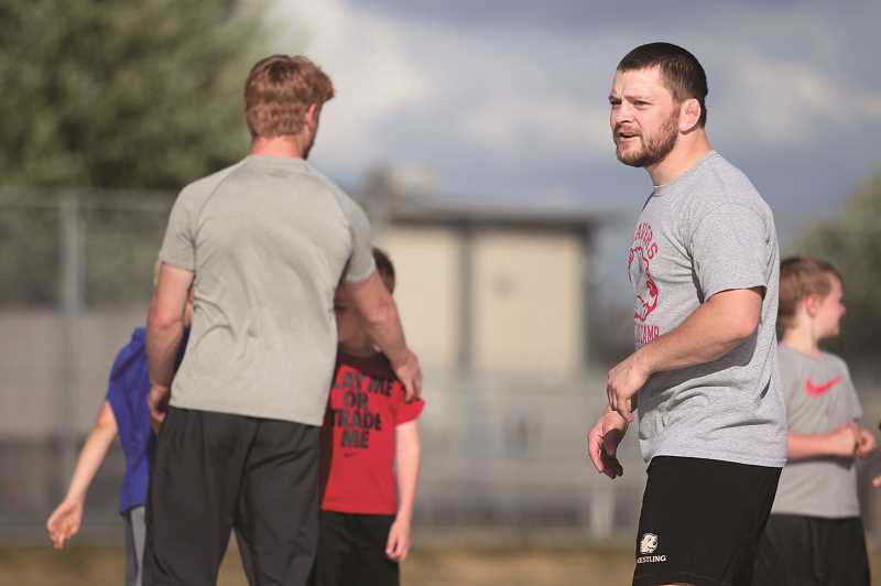 PMG PHOTO: PHIL HAWKINS - Sheppard served as a student assistant wrestling coach at Minot State last school year, returning home to Oregon last week to meet the North Marion wrestling team.