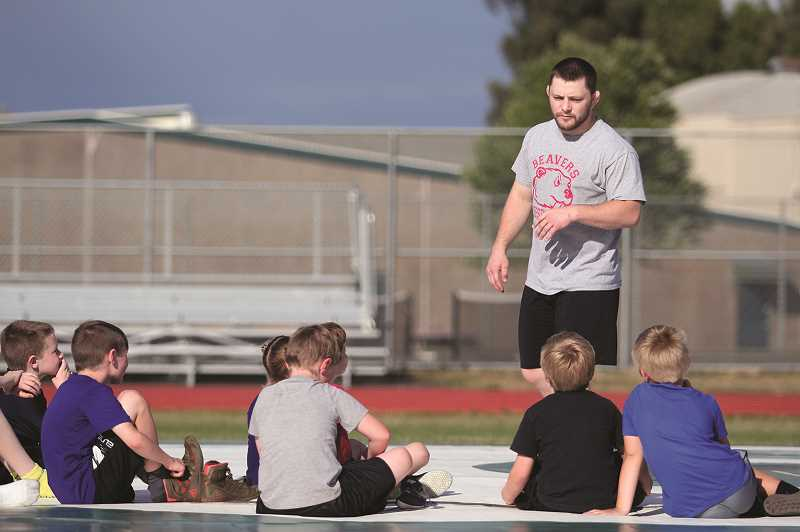 PMG PHOTO: PHIL HAWKINS - Sheppard was introduced to the Husky wrestling community last week with a team barbecue, followed by a pair of outdoor wrestling camps for kids and high school student athletes.