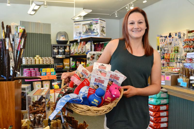 PMG PHOTO: BRITTANY ALLEN - Anna Judd specializes in selling natural pet food and treats at Dolly's Pet Shoppe.