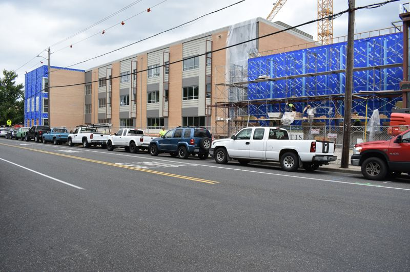 PMG PHOTO: TERESA CARSON - The facade of the new classroom wing of Gresham High School along Main Avenue is substantially completed. It uses the same warm beige brick as the old 1940 Art Deco building it replaces.