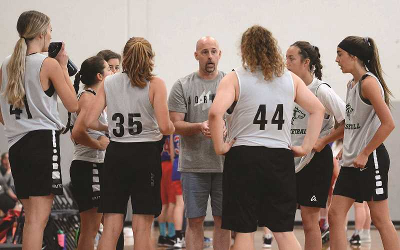 PMG PHOTO: DAVID BALL - Head coach Trevor Bodine has been impressed with how his team has responded to the challenges this summer of playing against a tough slate of competition with little time to practice due to construction at the high school.