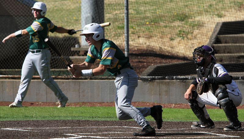 PMG PHOTO: MILES VANCE - West Linn's Kace Naone follows through after a hit during his team's 6-6 tie against Boise, Idaho, in the Firecracker Classic at Lakeridge High School on Saturday, June 29.