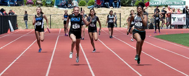 COURTESY PHOTO - Lake Oswego's Mia Brahe-Pederson races to victory in the last leg of th 4 x 100-meter relay in the USATF Oregon Association Junior Olympic Championships June 20- 23 at Newberg High School.