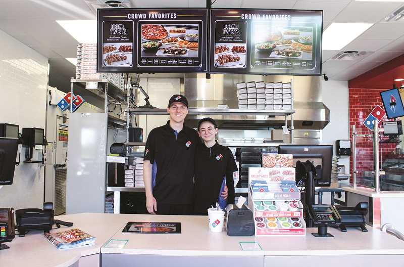 HOLLY SCHOLZ/CENTRAL OREGONIAN - Bryan and Taryn Marx opened a Dominos franchise in June on Combs Flat Road, specializing in pizza, chicken and sub sandwiches.