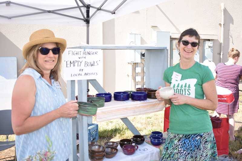 PMG PHOTO: EMILY LINDSTRAND - With bowls donated by local potters, the Estacada Area Food Bank raised funds and awareness about food insecurity during Estacada Uncorked.