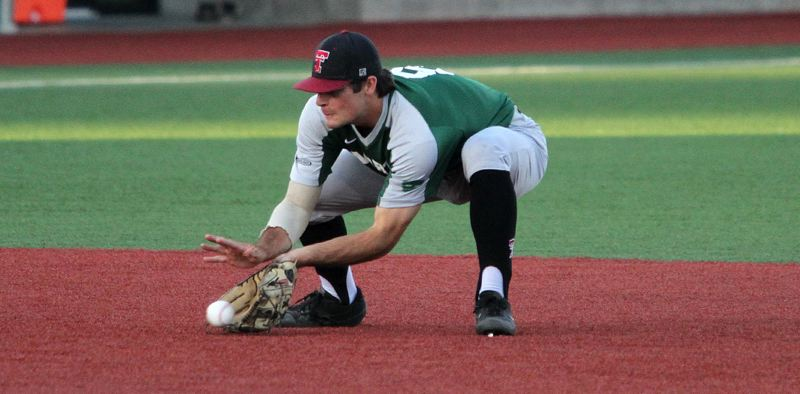 PMG PHOTO: MILES VANCE - Kyle Dernedde, a 2019 Tualatin High School graduate, fields a grounder while playing at shortstop for the North squad during play at the Freightliner Oregon All-Star Series on June 22.