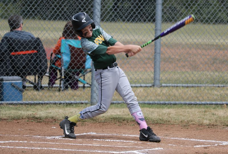 PMG PHOTO: JIM BESEDA - Putnam's Jameson Rhomberg takes a swing against Estacada in the opening game of the CCJBA Junior National county tournament at Colton Middle School.