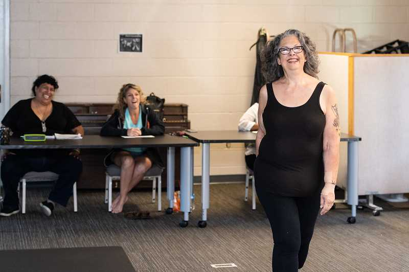 PMG PHOTO: CHRISTOPHER OERTELL - Looking forward to her third show with Curvy Chic, Carolyn Luff confidently struts during the June 17 open casting call.