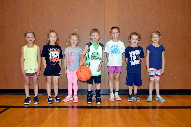 PMG PHOTO: CINDY FAMA - From left to right, Bristol Newman, Mia Hordichok, Copper Fischer, Ronald Hordichok, Macie Adams, Ryder Teune and Lexi Teune are ready to ball.