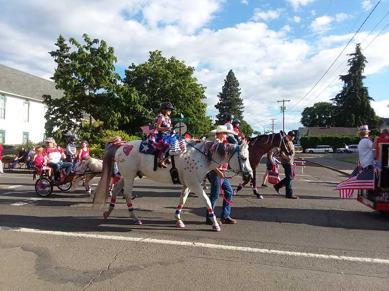 PMG FILE PHOTO - Pictured is Molalla's 2018 street parade.