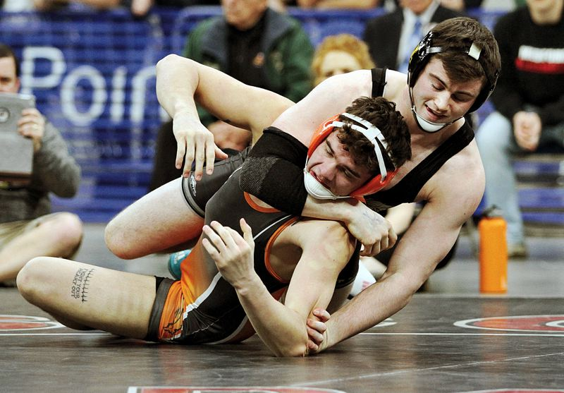 West Linn's Sean Harman left nothing to chance in his senior year, going unbeaten in 48 matches and winning the Class 6A state title at 170 pounds by technical fall over Roseburg's Logan Folsom.