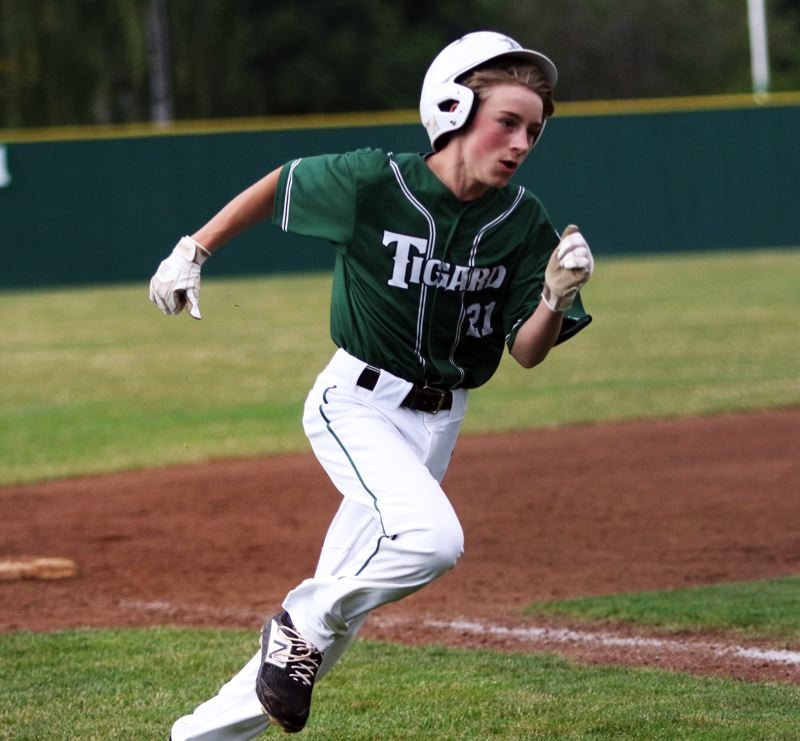 PMG PHOTO: DAN BROOD - Tigard's Owen Wright sprints to home plate to score the team's first run in the 12-2 win over Lake Oswego in Monday's game at the District 4 Little League Majors tournament.