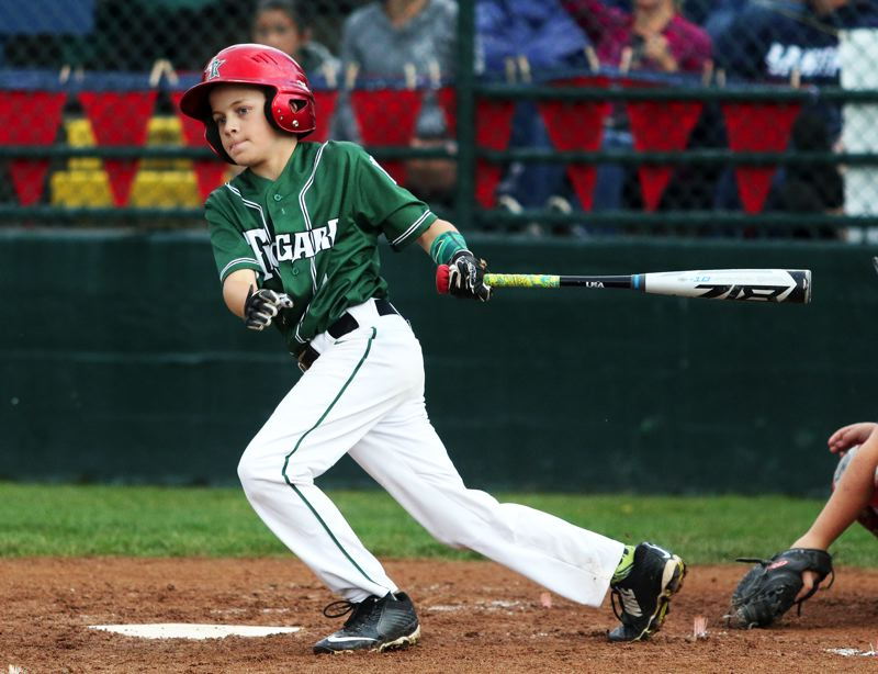 PMG PHOTO: DAN BROOD - Tigard's Carter Jordan takes a swing during the team's 12-2 win over Lake Oswego during play at the District 4 Little League Majors tournament on Monday.