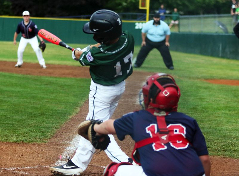 PMG PHOTO: DAN BROOD - Tigard's Dominic Taylor puts the ball in play during the team's 12-2 win over Lake Oswego at the District 4 Little League Majors tournament on Monday.