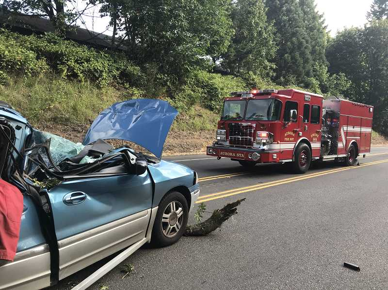 COURTESY OF AURORA FIRE DISTRICT - Aurora Fire District, Oregon State Police and Canby Fire District responed to a tree falling and striking a moving vehicle.