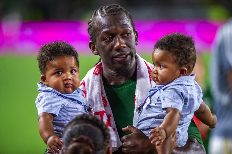 COURTESY PHOTO: DIEGO G. DIAZ - Veteran midfielder Diego Chara carries two of his children, Angel and Diego, after a Portland Timbers victory.