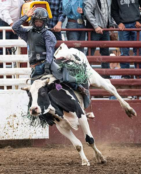 LON AUSTIN/CENTRAL OREGONIAN - Powell Butte's Parker Buchanan wins the junior bull riding Saturday night with a score of 70 points.