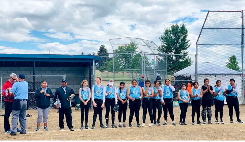 JENNIFFER GRANT - The Warm Springs Nation major softball team receives second place medals after losing to Redmond in the championship. Madras hosted the District 5 All-Star tournament June 21-27.