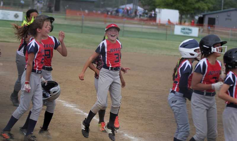 STEELE HAUGEN - Players from the Jefferson County minor softball team smile during the All-Star tournament.