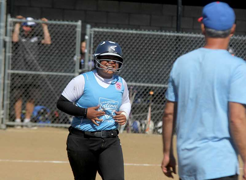 STEELE HAUGEN - Players from the Warm Springs Nation major softball team smile during the All-Star tournament.