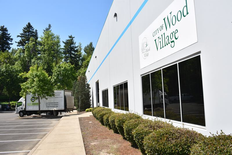 PMG PHOTO: MATT DEBOW  - Wood Village has installed a sign showing the location of the citys temporary City Hall in a building behind the Wood Village Bottle Drop redemption center., Gresham Outlook - News Employees will occupy leased space until permanent facility  is constructed at park   Wood Village City Hall offices move to temporary space