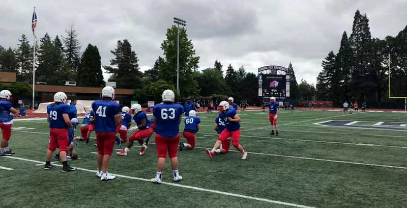 SUBMITTED PHOTO - The Madras football team does drills at the George Fox football camp June 21-24.