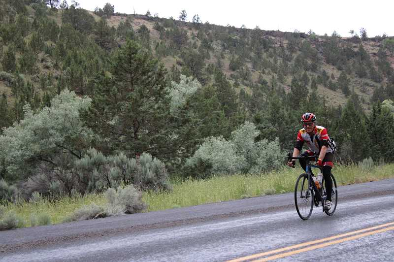 JENNIFFER GRANT - Bicycle riders stop in Madras during ride from Astoria to Boise, Idaho.
