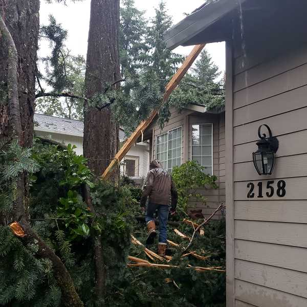 COURTESY PHOTO - Debris from the storm litters the house and property of Jeanne Gutfeld Lucas and her family on Hidden Springs Court.