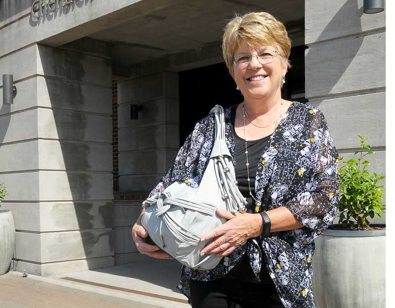 GRAPHIC FILE PHOTO - Cheri Meyerhofer with purses collected during last year's effort.