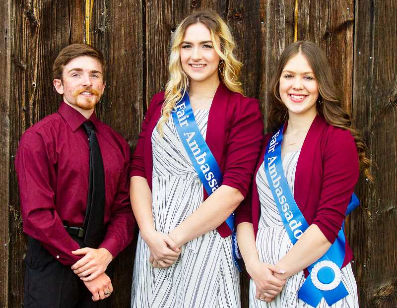SUBMITTED PHOTO - Christopher Trapp, Emily Hembree (center) and Isabell Tillotson are the 2019 ambassadors for the Yamhill County Fair and Rodeo.