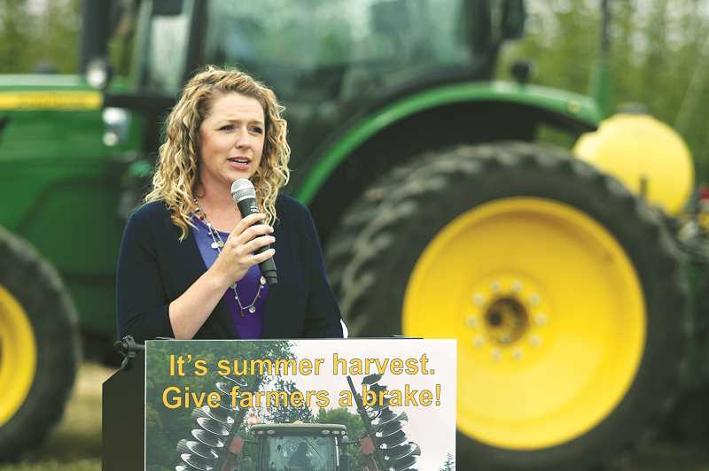 WOODBURN INDEPENDENT PHOTO: JUSTIN MUCH - Oregon Farm Bureau member Brenda Frketich of St. Paul addressed a rural-road safety gathering, held by OFB in conjunction with Marion County Sheriff's Office, Oregon Department of Transportation and Oregon Department of Agriculture.