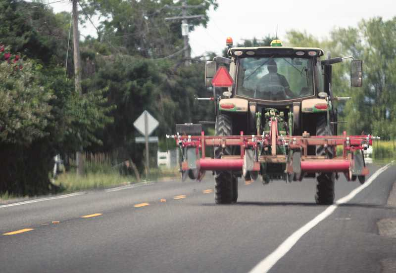 WOODBURN INDEPENDENT PHOTO: JUSTIN MUCH - Oregon Farm Bureau, working in conjunction with Marion County Sheriff's Office, Oregon Department of Transportation and Oregon Department of Agriculture, emphasize that motorists be watchful of farm equipment. ODOT statistics show an increase in crashes involving ag equipment in recent years.