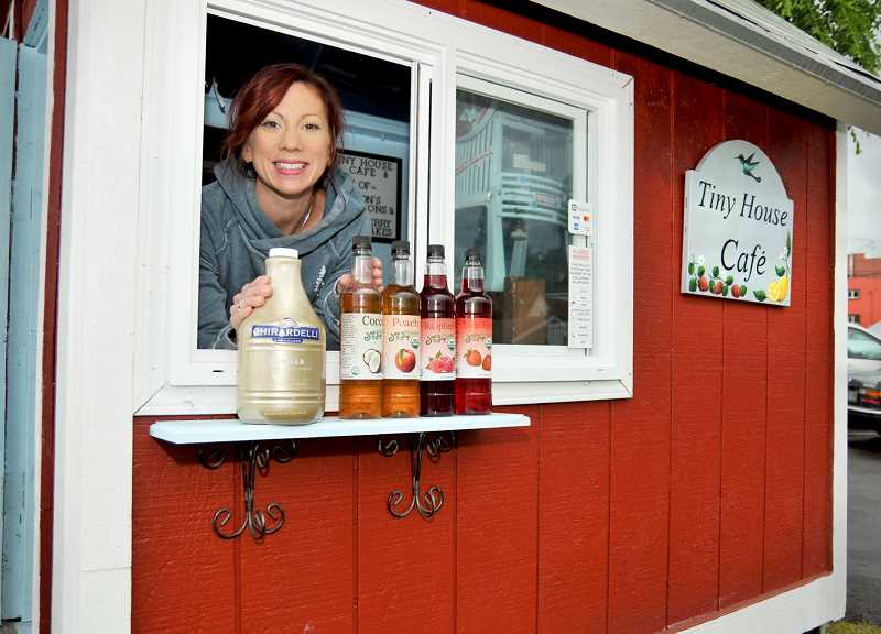 GRAPHIC PHOTO: GARY ALLEN - Delanie Simmons and two of her children recently launched a new business, Tiny House Café, where on Fridays they serve up sweet treats like shave ice and shortcakes.
