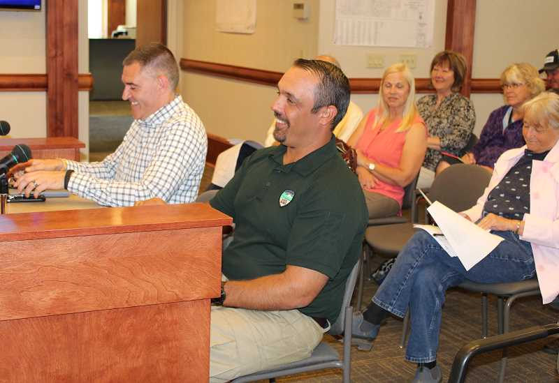 HOLLY M. GILL/MADRAS PIONEER - M.G. Devereux, left, deputy director of the Oregon Parks and Recreation Department, and J.R. Collier, manager of OPRD's mountain region, which includes Central Oregon, discuss the department's plan to update the Cove Palisades State Park master plan.
