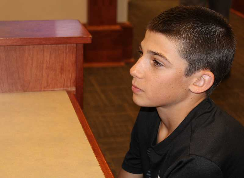 HOLLY M. GILL/MADRAS PIONEER - Cole Roff, 12, of Culver, tells the Jefferson County Commission that he is afraid that a resort on the rim above Lake Billy Chinook would affect his family's abillity to farm, and his future.