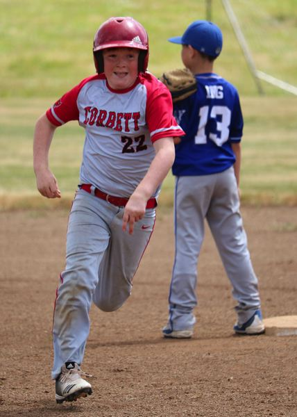 PMG PHOTO: JIM BESEDA - Corbetts Turner Van Hee rounds second base during the teams second-round win over Woodburn at last weekends county tournament.