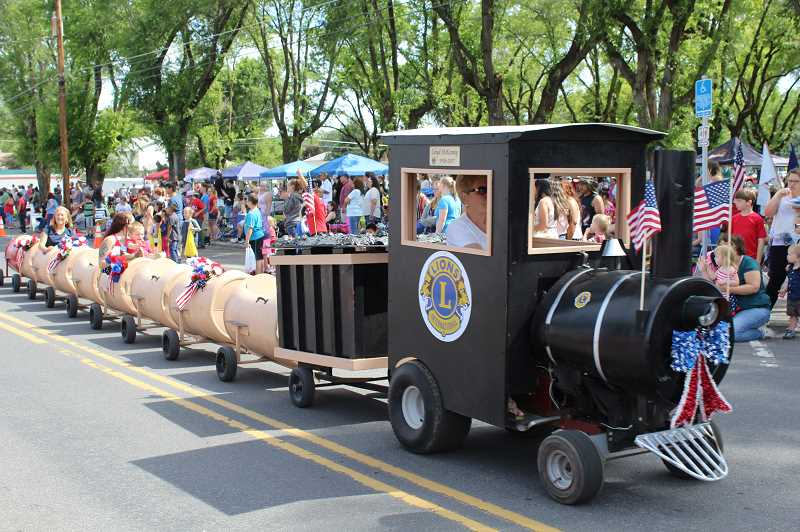 HOLLY M. GILL/MADRAS PIONEER - The Crooked River Ranch Lions Club train carried passengers in last year's Fourth of July parade.