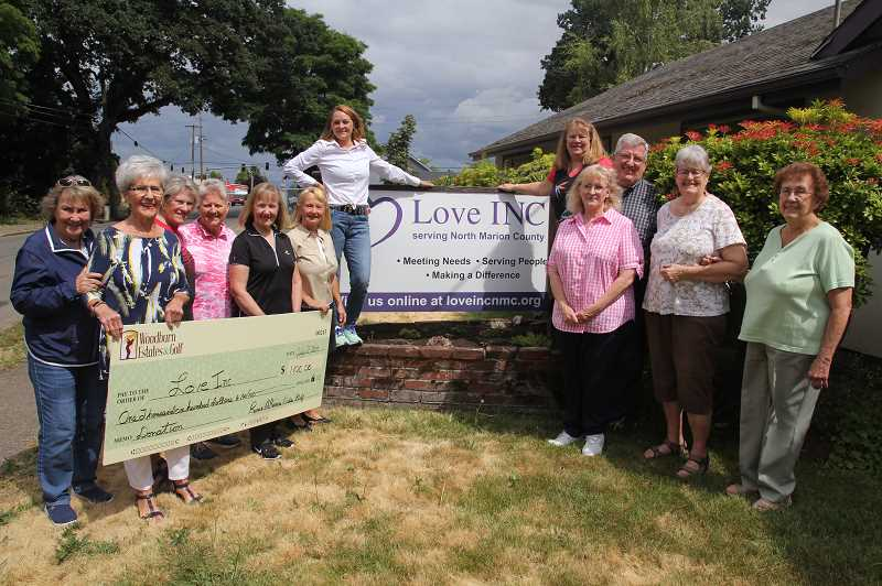 PMG PHOTO: JUSTIN MUCH - Rose-A-Rama Golf Tournament organizers present a $1,100  check to directors and personnel at Love Ink in Woodburn, Tuesday, July 2.