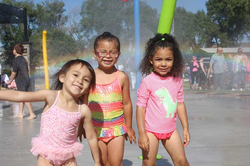DESIREE BERGSTROM/MADRAS PIONEER - From left to right, Bella Valero, 4, Trinnity Clark, 5, and AnnaLynn Goodman,3, preschool best friends, are all giggles and smiles.