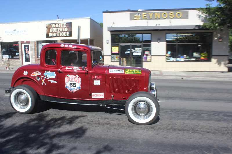DESIREE BERGSTROM/MADRAS PIONEER - One of approximatly 100 vehicles participating in The Great Race zips through Madras Friday morning. Many of the racers honked and waved locals as they rolled along through town.