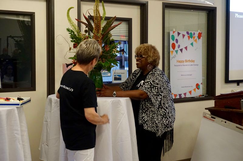 PMG PHOTO: CLAIRE HOLLEY - Respond to Racism co-founder Willie Poinsette beams when she finds out the flowers are for her.