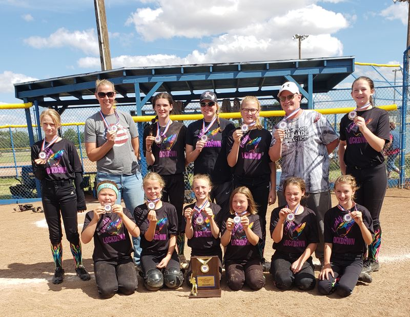 COURTESY PHOTO: ST. HELENS GIRLS SOFTBALL - The Lady Lockdown girls softball team shows off its second-place trophy and medals at the 12-and-under state tournament in Albany.