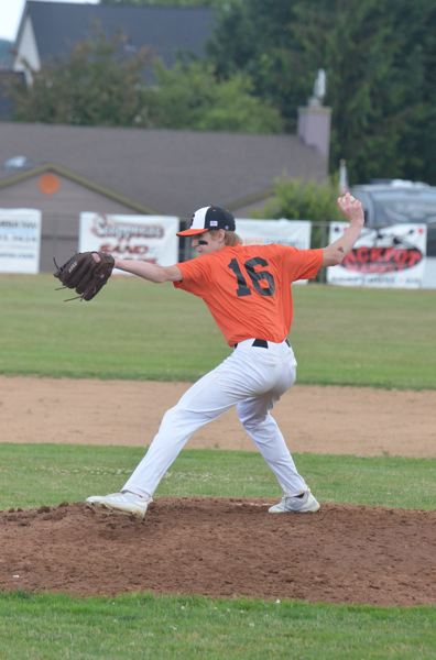 COURTESY PHOTO: JOHN BREWINGTON - Thomas Greiner pitches for Scappoose during a recent OIBA baseball game on the Indians' home field.