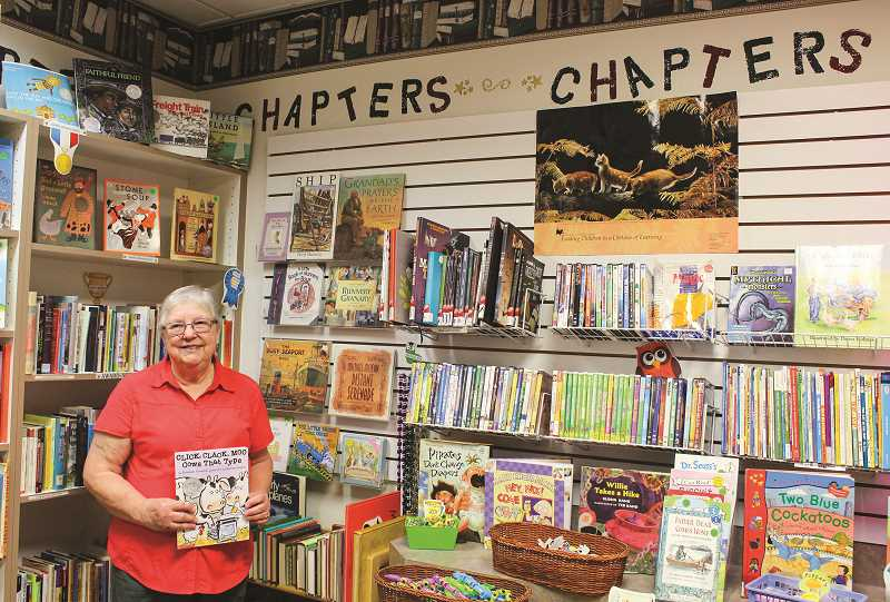 JASON CHANEY - Susan Swan, coordinator of the Chapters book shop, stands inside the store operated by Friends of the Crook County Library volunteers. The store supports Crook County Library projects and other needs.