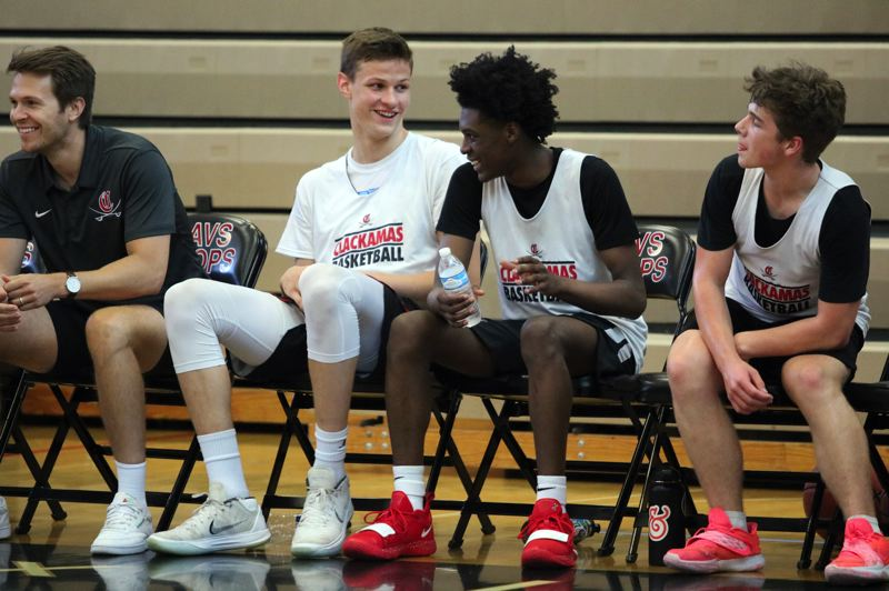 PMG PHOTO: JIM BESEDA - Ben Gregg (second from left) transferred to Clackamas from 2A Columbia Christian and Damontae Burns (third from left) transferred to Clackamas from 5A Parkrose after their sophomore years.