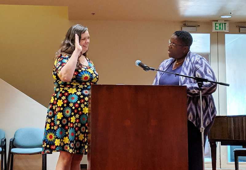 PMG PHOTO: COURTNEY VAUGHN - Eilidh Lowery is sworn in to the Portland Public Schools board Tuesday, July 2 by Oregon Supreme Court Justice Adrienne Nelson.