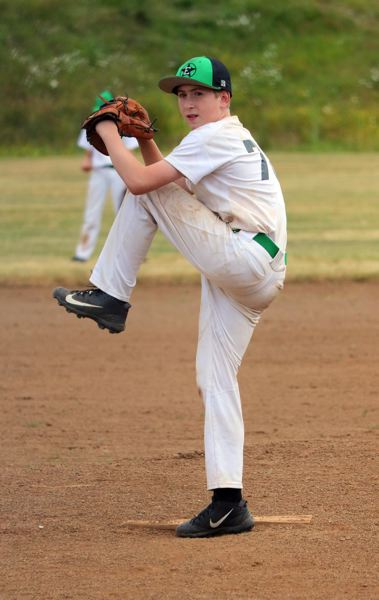 PMG PHOTO: JIM BESEDA - Estacada pitcher Gavin Gates winds up for a throw.