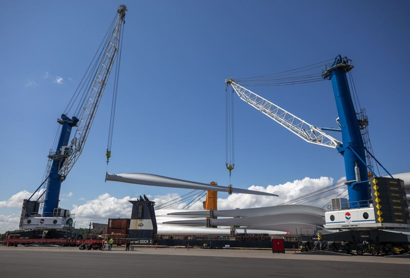 PMG: JONATHAN HOUSE  - Some of the 198 wind turbine blades made by Vestas in Italy being unloaded at the Port of Vancouver, Washington. The hardware is part of a new generation of bigger blades that bring more turning power and thus more electricity (35% in this case) to wind farms around the world.