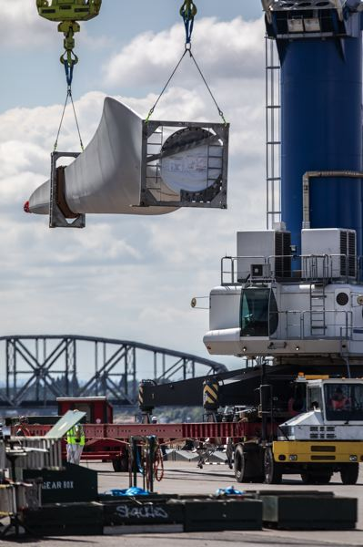 PMG: JONATHAN HOUSE  - Some of the 198 wind turbine blades made by Vestas in Italy being unloaded at the Port of Vancouver, Washington.