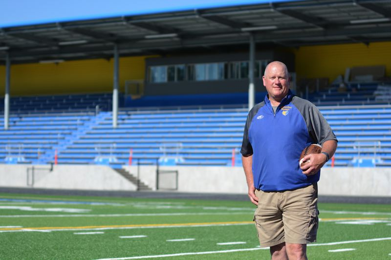PMG PHOTO: DAVID BALL - Barlow High football coach Terry Summerfield is excited to tackle his first season at the new campus stadium in the fall.
